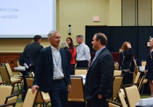 Summit attendees networking between sessions