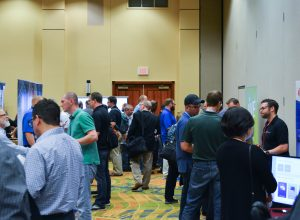Summit attendees and vendors networking between sessions