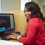 Photo of female student working at a computer