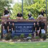 Students at Carl Albert State College Campus Sign